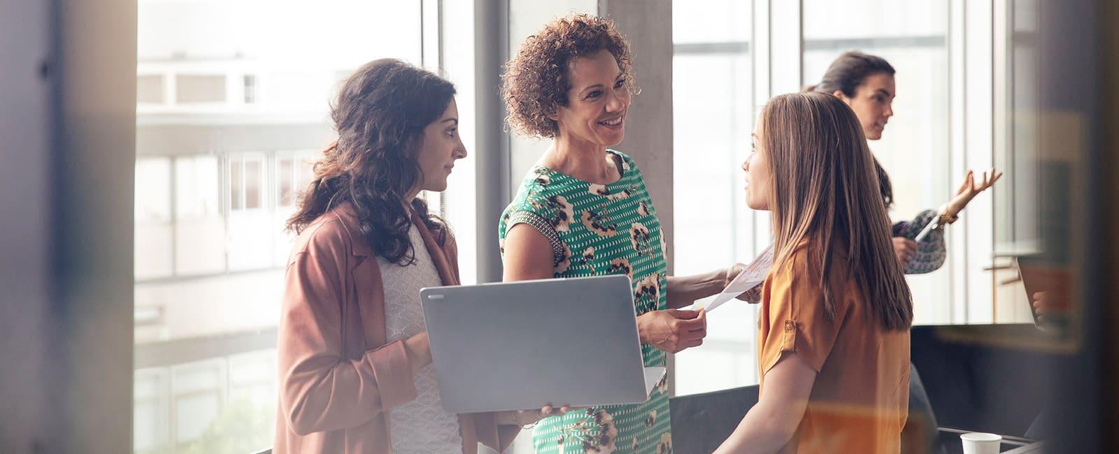 three female employees talking.
